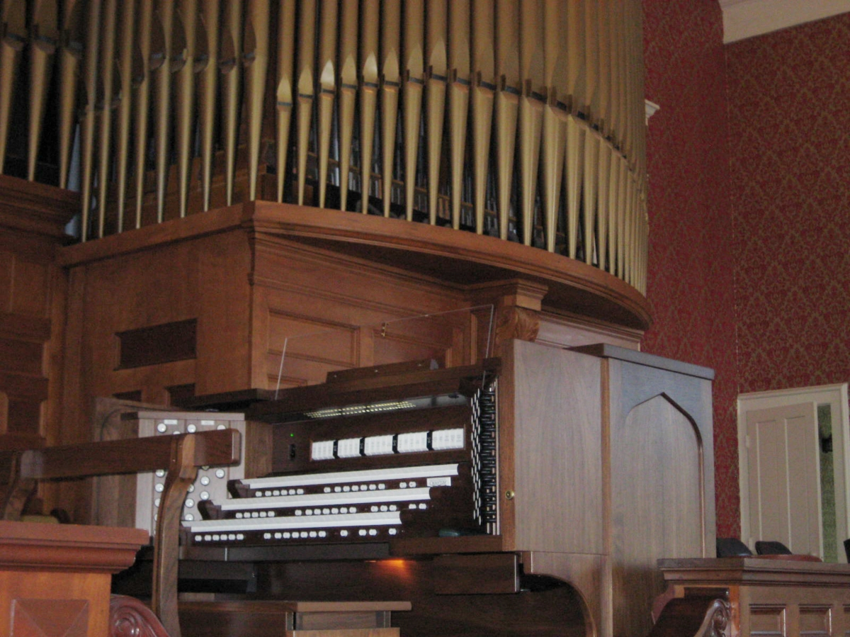SPENCER CONGREGATIONAL CHURCH, SPENCER, MA - THREE MANUAL  Spencer Congregational Church in Spencer, MA recently combined a 33 stop/36 rank Emmons-Howard pipe organ to 24/31 ranks of Allen Digital additions using a custom built 3 manual drawknob console. The resulting instrument has a specification of 57 stops/ 67 ranks. This custom designed instrument is a welcomed addition to a music program led by Sarah Rutkiewicz.  The organ committee needed to address the shortcomings of their 35 year old console as well as the tonal limitations of their organ. The Emmons-Howard organ had gone through three major rebuilds in its life. It was conceived as a warm romantic organ with an orchestral breadth to its sound. However, work done in 1967 significantly altered the original design and introduced neo-baroque stops into its specification. Unfortunately, this attempt of unifying romantic and new-baroque elements was not successful. The committee decided to correct this battle of styles and replace the console. They unanimously found that the Allen Organ Company could address all their concerns with a collection of complementary digital pipe stops and a three manual Drawknob console. The new instrument's specification includes of a new state trumpet, the addition of independent pedal stops and many new foundation stops and solo stops. The console also includes a comprehensive MIDI system with velocity sensitive keyboards.