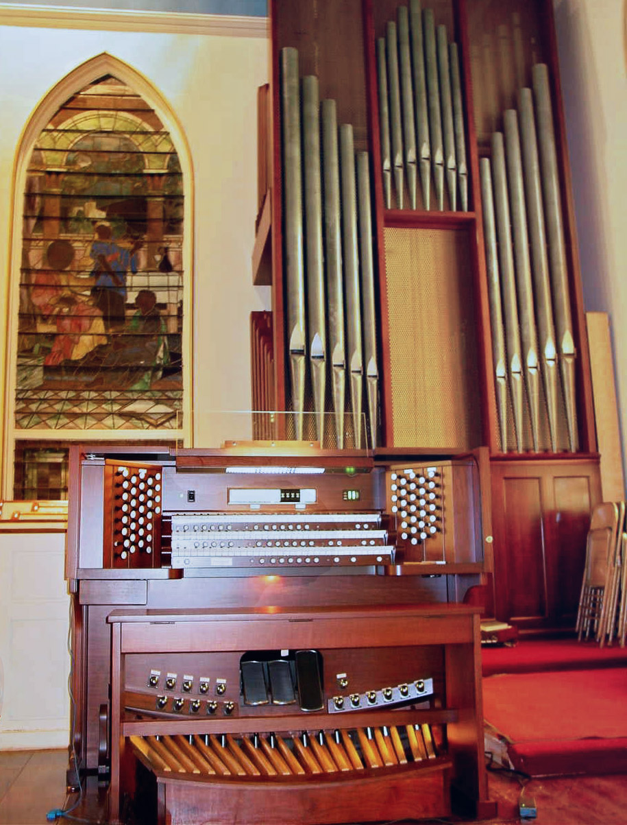 FIRST CONGREGATIONAL CHURCH, SUTTON, MA - THREE MANUAL  Allen/Wicks 55 stop 62 ranks 3 manual drawknob organ.  The First Congregational Church of Sutton, MA is an active and growing UCC congregation. The church owned a Wicks 11 stop 13 rank neo-baroque 2 manual console and they sought a broader specification to accompany its active and growing choir. The choir presents a wide range of repertoire and needed an organ that had a broader tonal palette and MIDI capabilities. Space is limited in this historic church and a larger pipe organ was not feasible. The church selected an Allen Organ 3 manual Renaissance organ. We found that the pipes could be revoiced to create a broader tone with a softer speech characteristic. The Allen Organ specification was in turn custom designed on site to create an ideal blend of voices. A Vista Navigator MIDI module was added in 2013. The organ was dedicated by Diane Bish.
