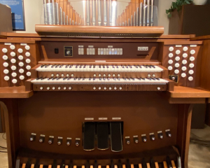 Allen ADC-3160 Organ- This fully appointed drawknob organ was built in 1987 and is in excellent condition. It includes 4 external speakers and is ideally suited for a medium to large sized church. The console controls include a full capture system including general, divisional, and toe pistons, A & B memory levels, bass coupler, and two Alterable Voice slots. It also has two expression pedals and crescendo. This instrument has been serviced by our authorized Allen Organ technician since it was new and it comes with a 90 day parts and labor warranty. Stoplist Pedal: Diapason 16, Bourdon 16, Quintaten 16 (Sw), Octave 8, Gedackt 8, Choral Bass 4, Mixture III, Posaune 16, Trompette 8 (Sw) Great: Quintaten 16 (Sw), Principal 8, Rohrflote 8, Violas (II/Sw) 8, Octave 4, Spitzflote 4, Super Octave 2, Waldflote 2, Mixture IV, Krummhorn 8, Tremulant Swell: Quintaten 16, Gedackt 8, Violas (II) 8, Spitz Prinzipal 4, Koppel Flote 4, Nasat 2 2/3, Blockflote 2, Terz 1 3/5, Mixture III, Basson 16, Trompette 8, Clairon 4, Tremulant -  $12,750 (delivery and installation not included)